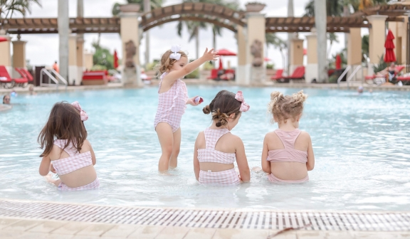 rear view of children playing on the pool