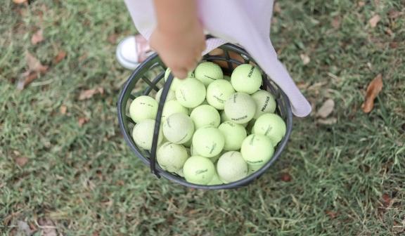 Golf balls in golf range baskets