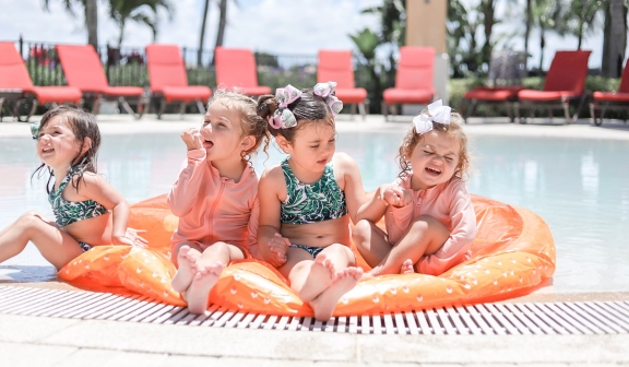 Children on an inflatable pool float