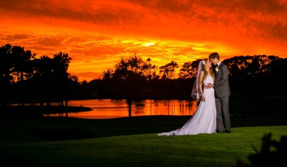 Wedding couple embrace at sunset